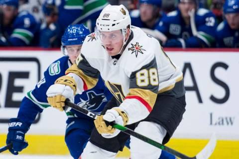 Vancouver Canucks center Elias Pettersson (40) chases Vegas Golden Knights defenseman Nate Schm ...