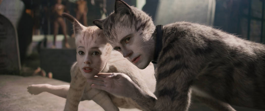 """(from left) Victoria (Francesca Hayward) and Munkustrap (Robbie Fairchild) in """"Cats,"""" ..."""
