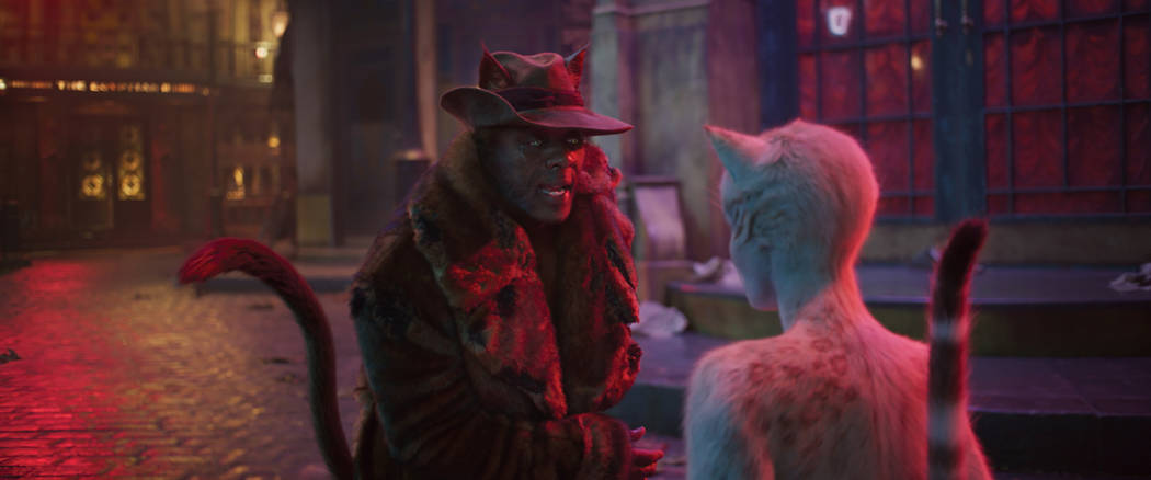 """(from left) Macavity (Idris Elba) and Victoria (Francesca Hayward, back to camera) in """"Cat ..."""