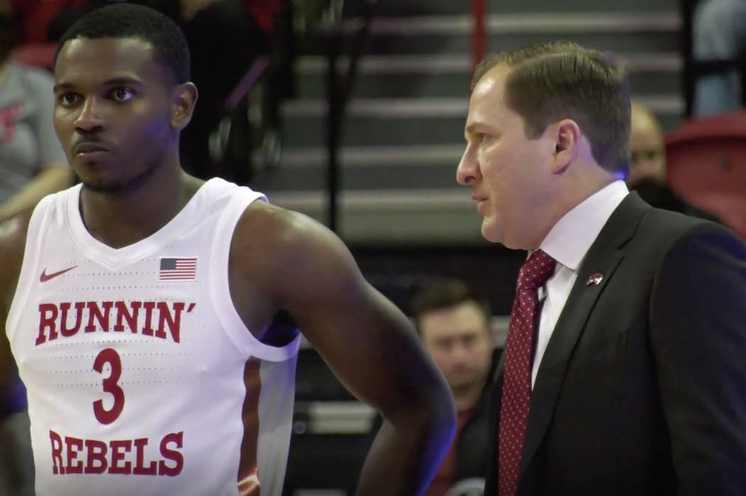 Amauri Hardy and UNLV head coach T.J. Otzelberger on the sideline during a loss to Pacific on W ...
