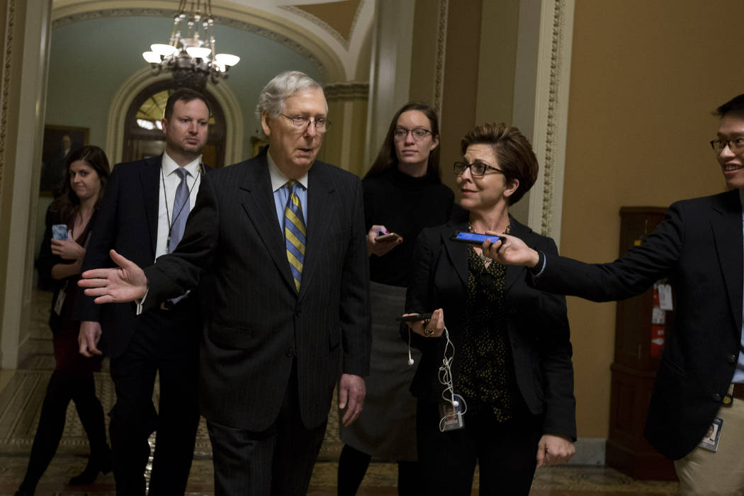 Senate Majority Leader Mitch McConnell, R-Ky., talks to reporters as leaves the senate chamber ...