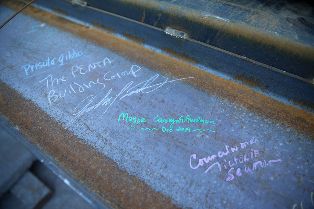 A beam with signatures of guests during a topping-off ceremony for the Expo at World Market Cen ...
