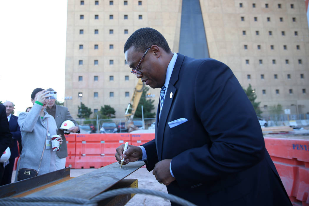Las Vegas Councilman Cedric Crear signs a beam during a topping-off ceremony for the Expo at Wo ...