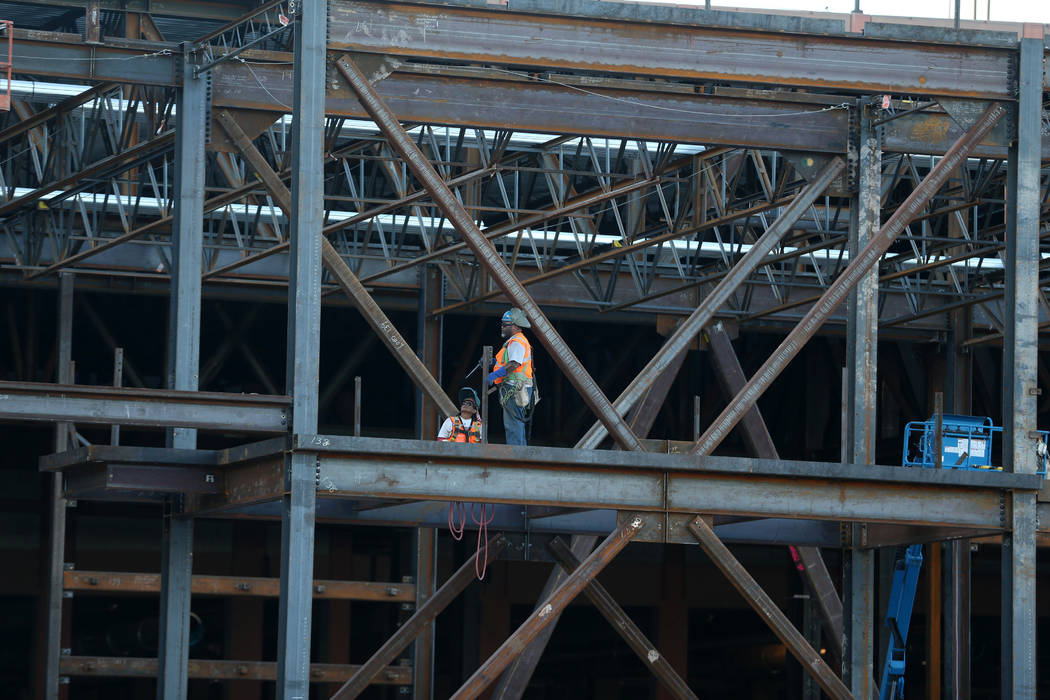 Workers at the construction site for the Expo at World Market Center in Las Vegas, Thursday, De ...
