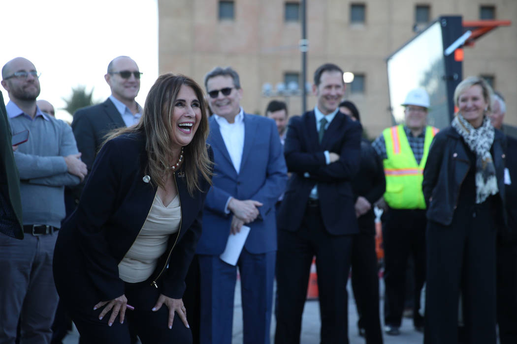 Las Vegas Councilwoman Victoria Seaman shares a laugh during a topping-off ceremony for the Exp ...