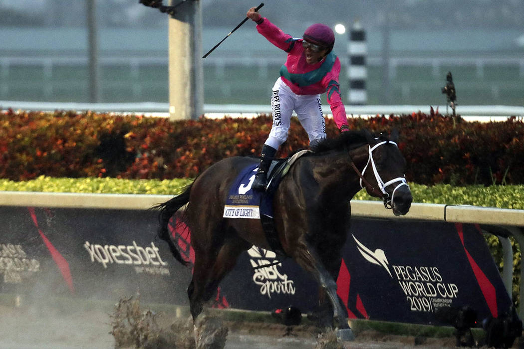Javier Castellano celebrates aboard City of Light after winning the Pegasus World Cup Invitatio ...