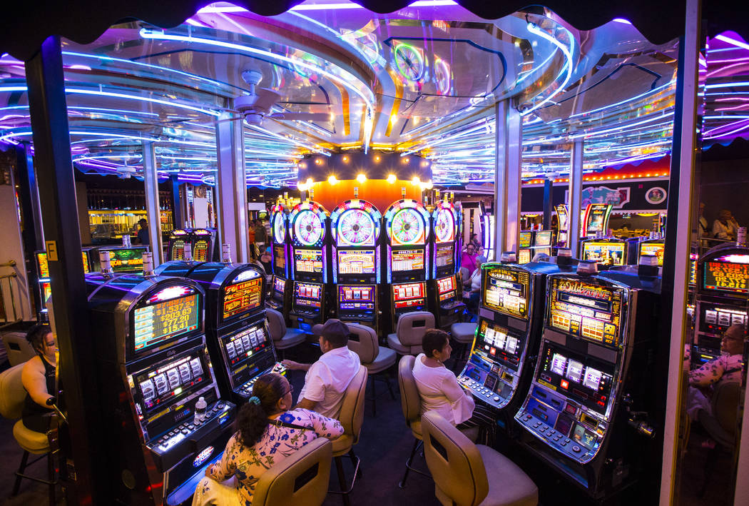 Hotel guests gamble on slot machines on a rotating surface at Circus Circus in Las Vegas on Sat ...