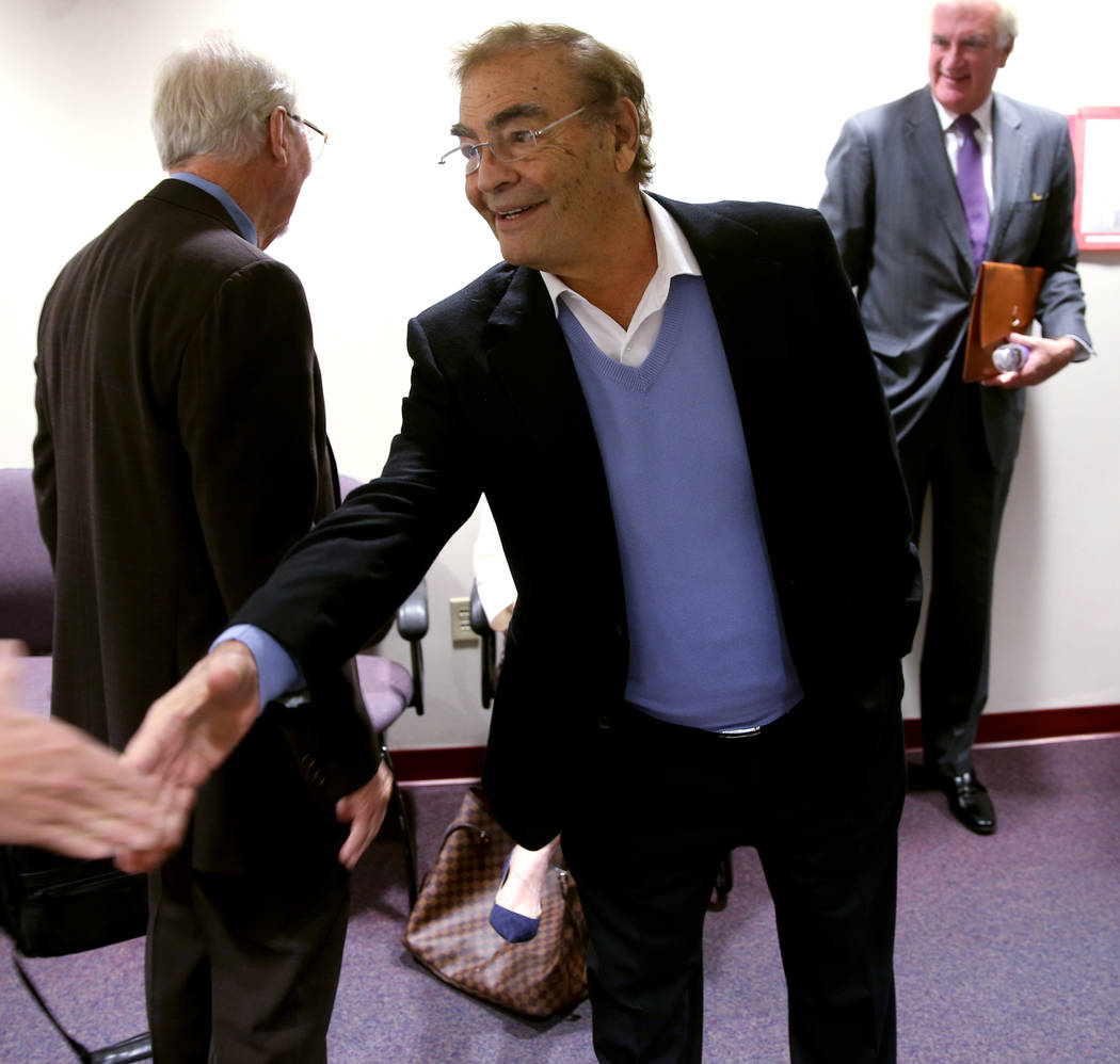 Phil Ruffin shakes hands with members of the news media while waiting to appear before Nevada G ...