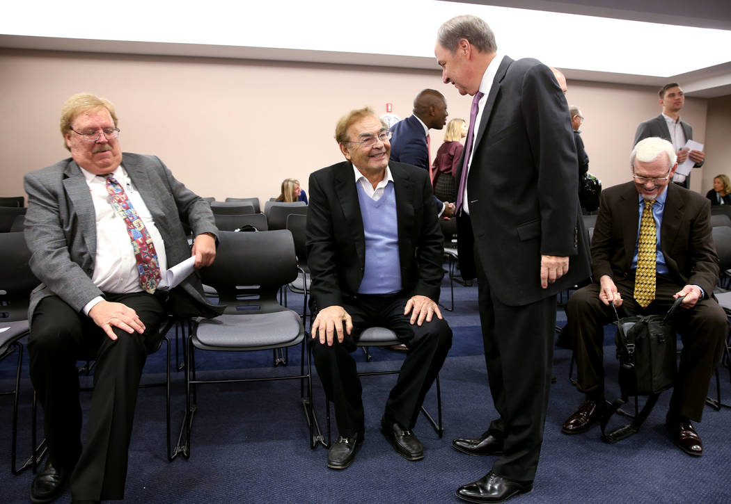 Phil Ruffin, center, visits with Nevada Gaming Commission member Steve Cohen before a NGC heari ...