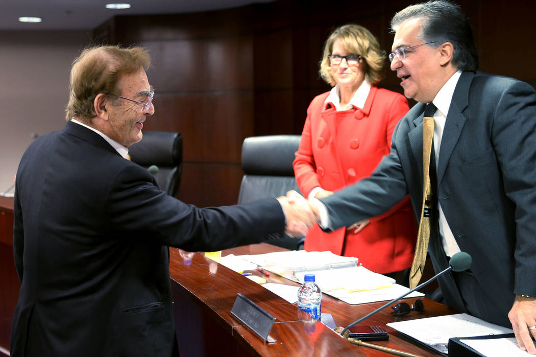 Phil Ruffin, left, greets Nevada Gaming Commission members Chairman Tony Alamo and Commissioner ...