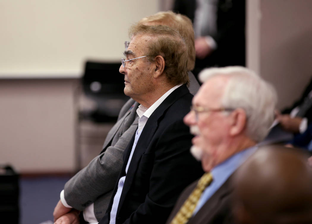 Phil Ruffin, left, waits to appear before Nevada Gaming Commission at the Sawyer Building in La ...