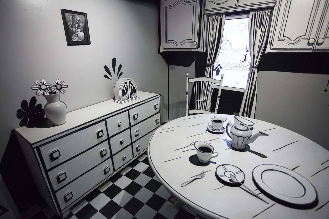 A monochromatic kitchen is filled with monsters at Meow Wolf House of Eternal Return.