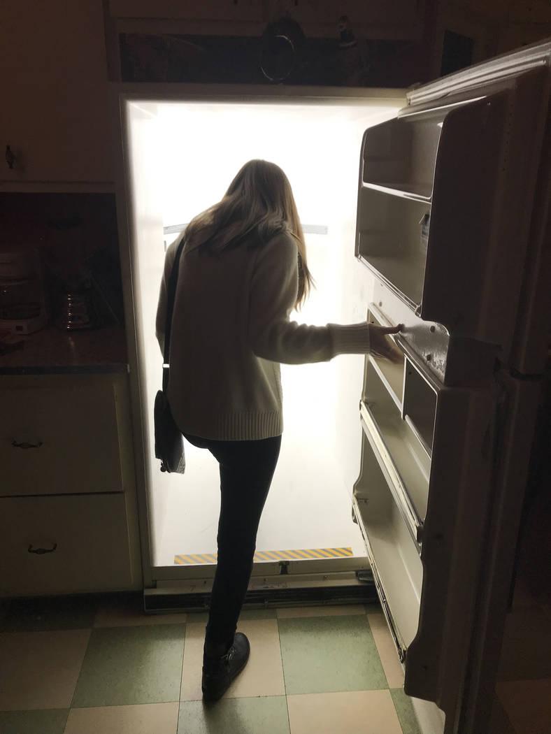 A visitor at Meow Wolf, Santa Fe walks through a refrigerator door portal. (Jan Jackson/Special ...