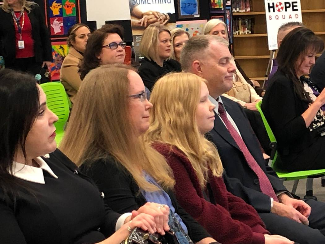 """Attendees are pictured at a kick-off event for """"Henderson Hope Squad"""" Dec. 9 at Miller Midd ..."""