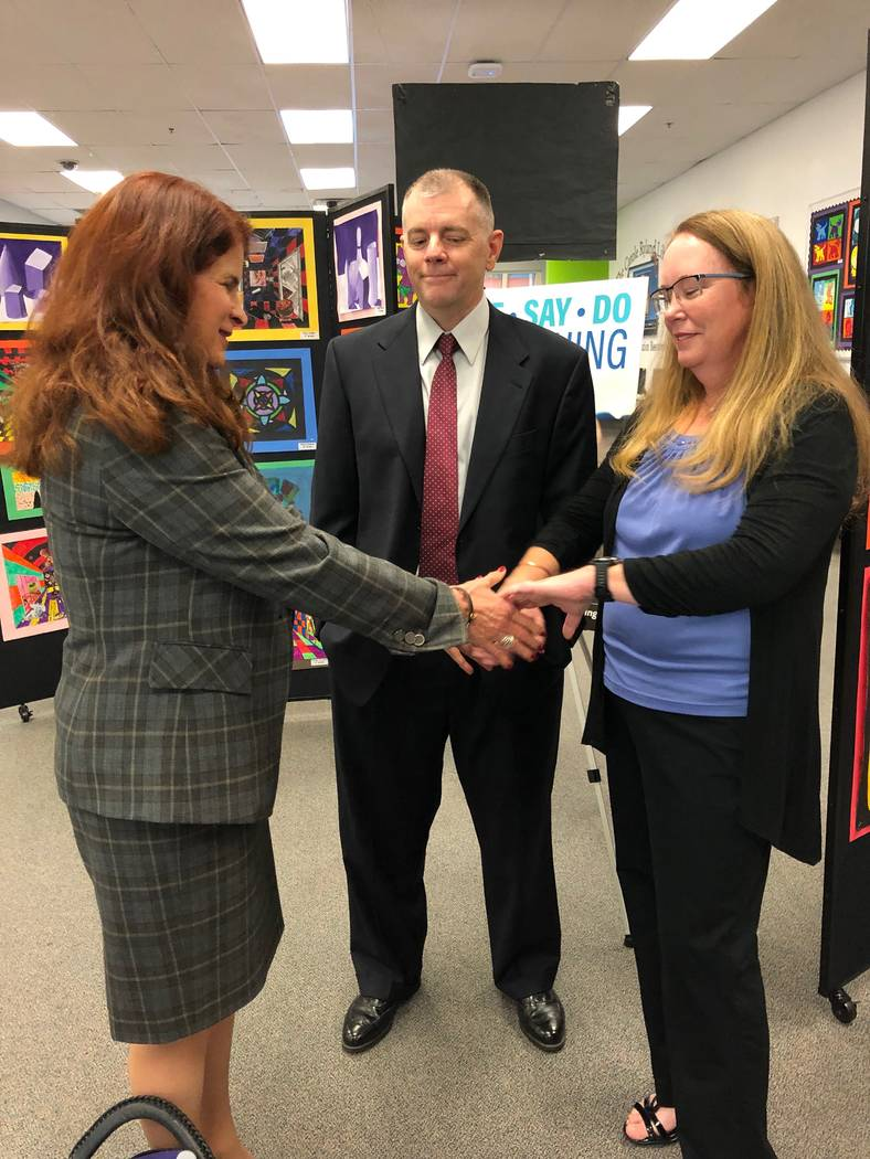 Mayor Debra March is pictured with Melissa and Earl Hawkes, parents of Caera Hawkes, at a kick- ...