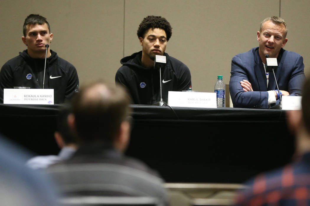 Boise State Broncos defensive back Kekaula Kaniho, from left, wide receiver Khalil Shakir, and ...
