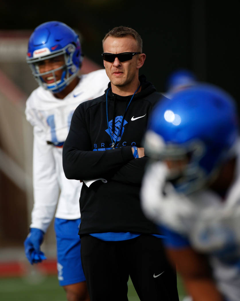 Boise State head coach Bryan Harsin, center, is seen during football practice in Las Vegas, Wed ...