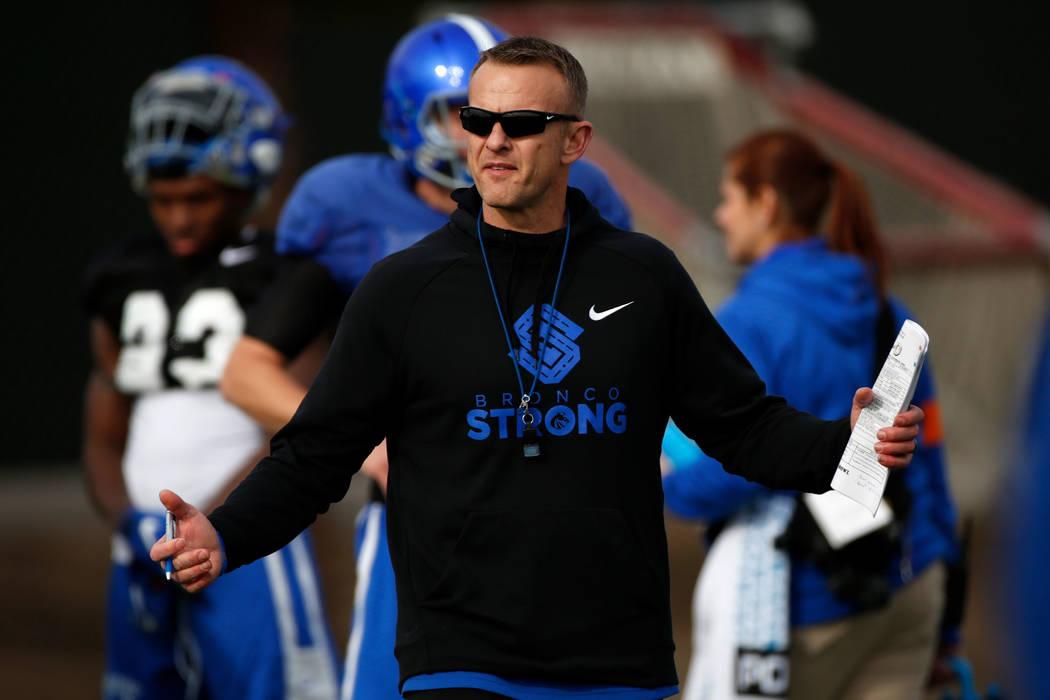 Boise State head coach Bryan Harsin, left, is seen during football practice in Las Vegas, Wedne ...