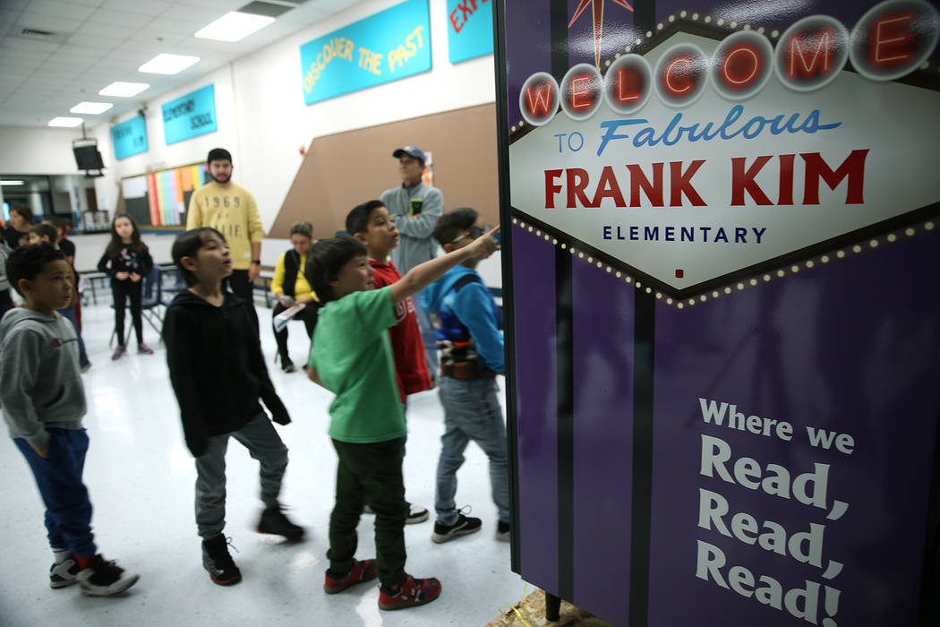 Students look at a book vending machine at Frank Kim Elementary School in Las Vegas, Thursday, ...