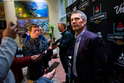 Washington head coach Chris Petersen speaks with reporters ahead of the Las Vegas Bowl NCAA col ...