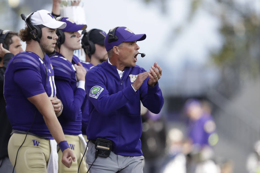 Washington head coach Chris Petersen looks on from the sidelines during an NCAA college footbal ...