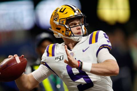 In this Dec. 7, 2019, file photo, LSU quarterback Joe Burrow (9) warms up before the Southeaste ...