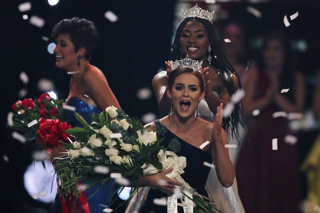 Camille Schrier, of Virginia, right, reacts after winning the Miss America competition at the M ...