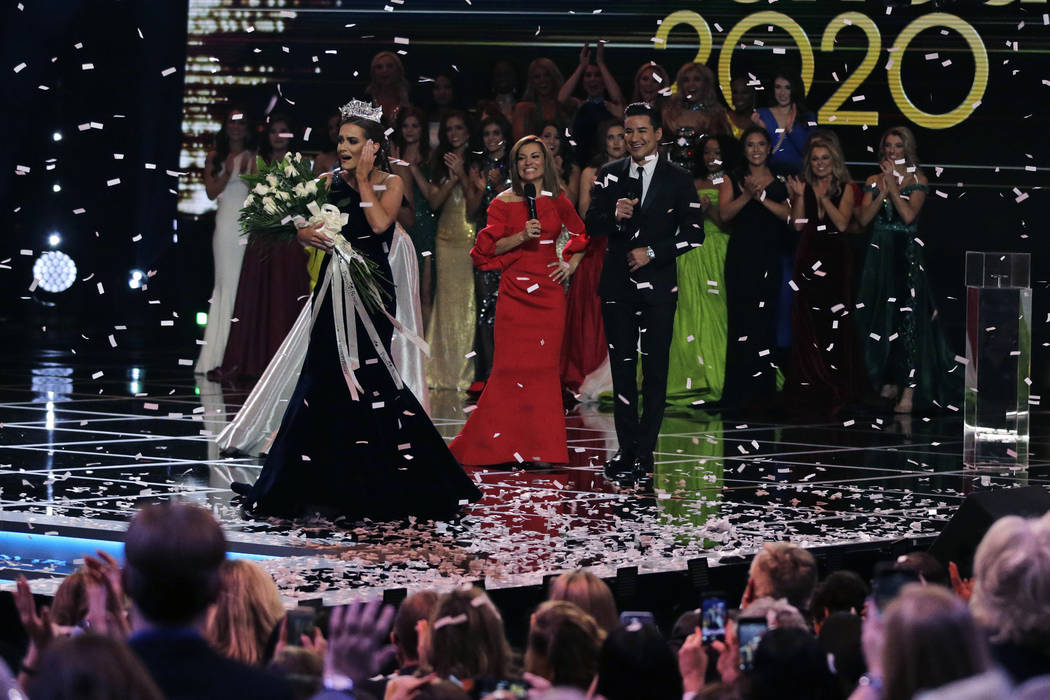 Camille Schrier, of Virginia, left, reacts after winning the Miss America competition at the Mo ...