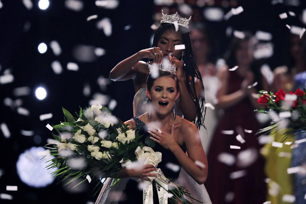 Camille Schrier, of Virginia, reacts as she is crowned after winning the Miss America competiti ...