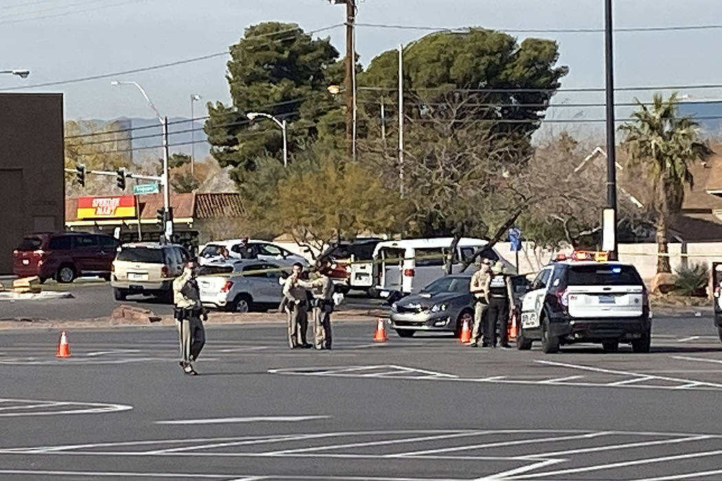 Police investigate a shooting in a Walmart parking lot near East Tropicana Avenue and McLeod Dr ...