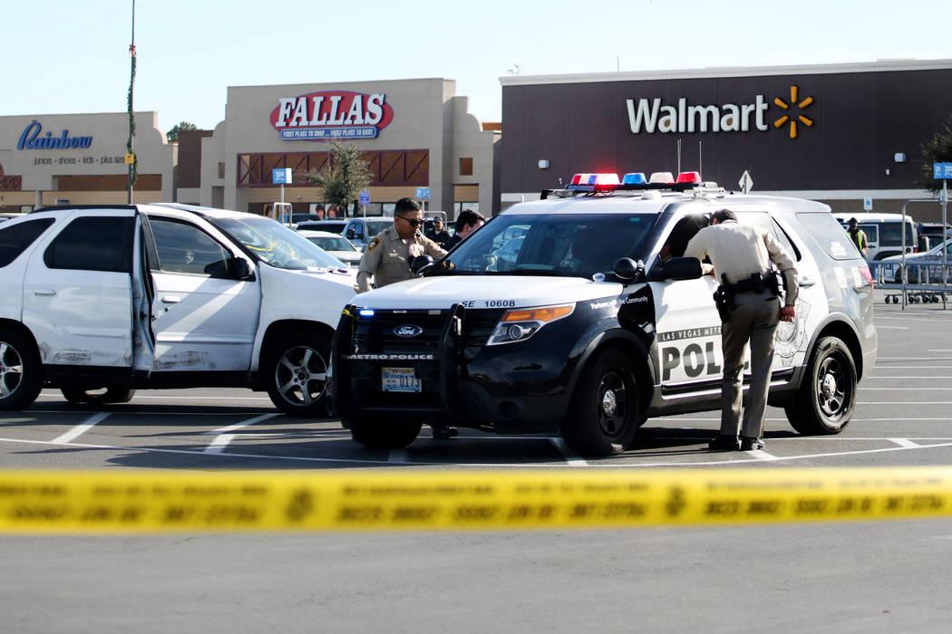 Police block off a parking lot near a Walmart Supercenter on the 3000 block of East Tropicana A ...