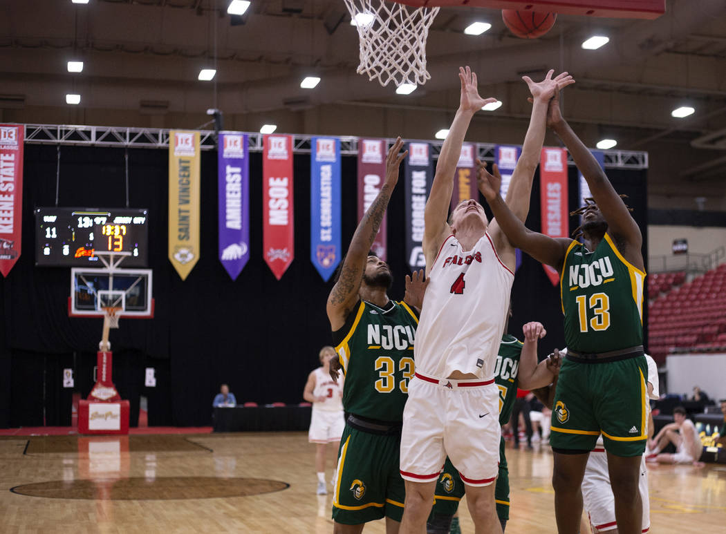 University of Wisconsin-River Falls' forward Alex Ohde (4) shoots a point as New Jersey City Un ...