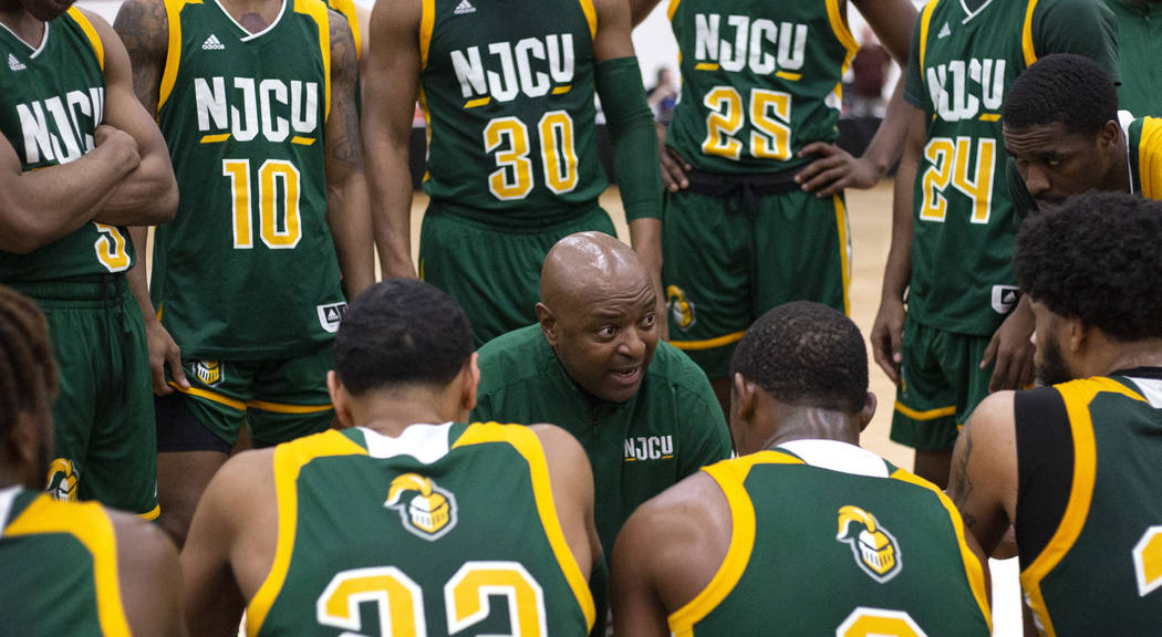 New Jersey City University's head coach Marc Brown speaks to his team in a timeout during the D ...