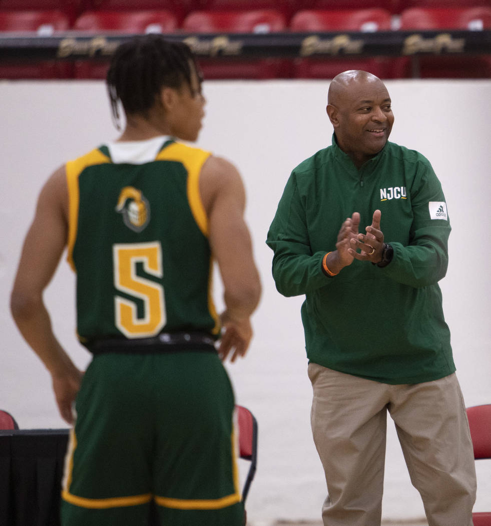 New Jersey City University's head coach Marc Brown claps after his team made a point during the ...