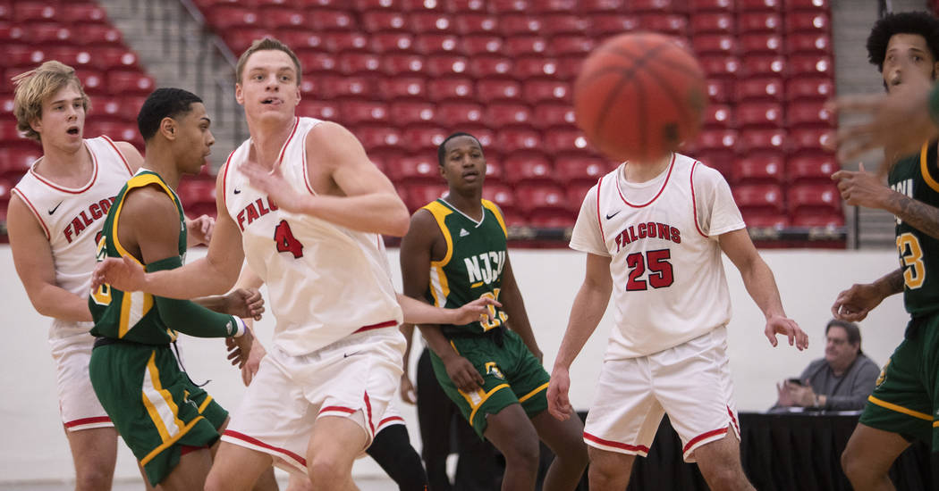 University of Wisconsin-River Falls' forward Alex Ohde (4) watches as his pass is about to be i ...
