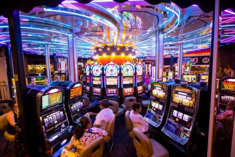 Hotel guests gamble on slot machines on a rotating surface at Circus Circus in Las Vegas, June ...