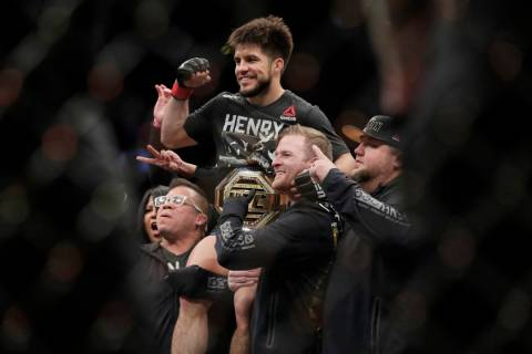 Henry Cejudo celebrates after a flyweight mixed martial arts championship bout against TJ Dilla ...
