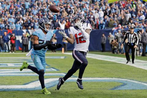 Houston Texans wide receiver Kenny Stills (12) catches a 12-yard pass for a touchdown as he is ...