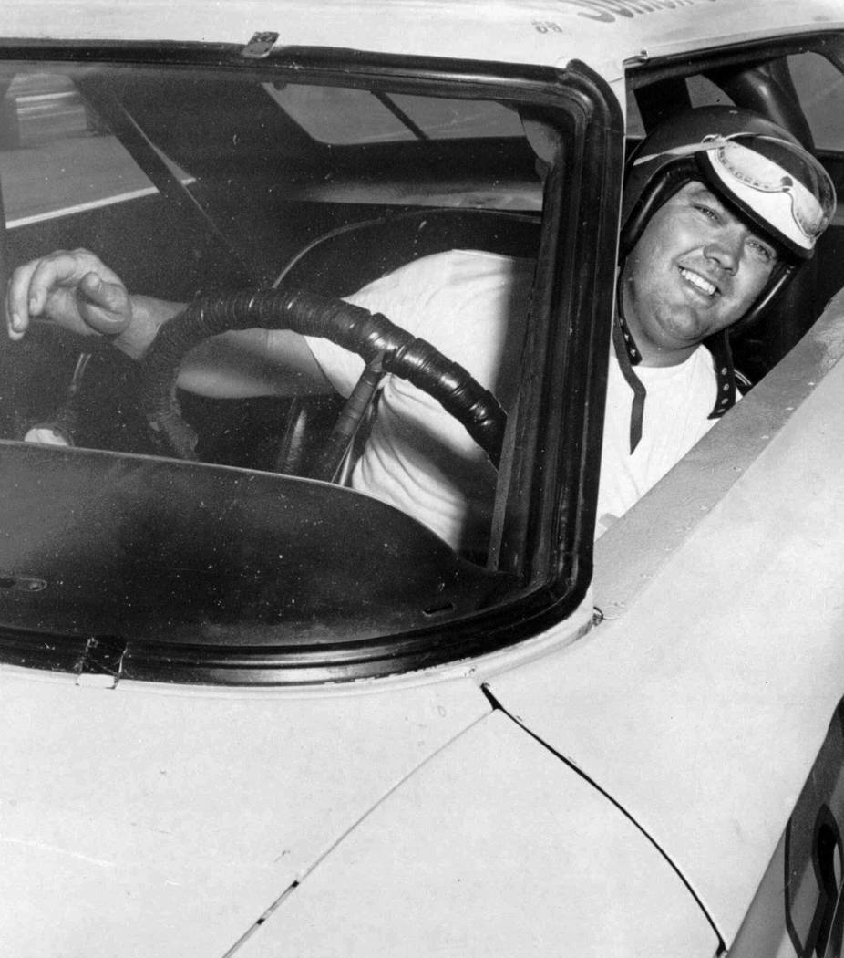 In this June 3, 1964, photo, Junior Johnson peers from his car after winning the pole position ...