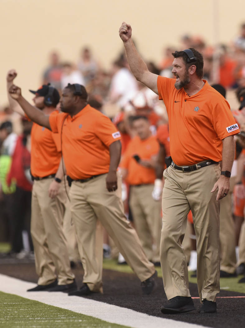Oklahoma State defensive line coach Joe Bob Clements yells to his team during a college footbal ...