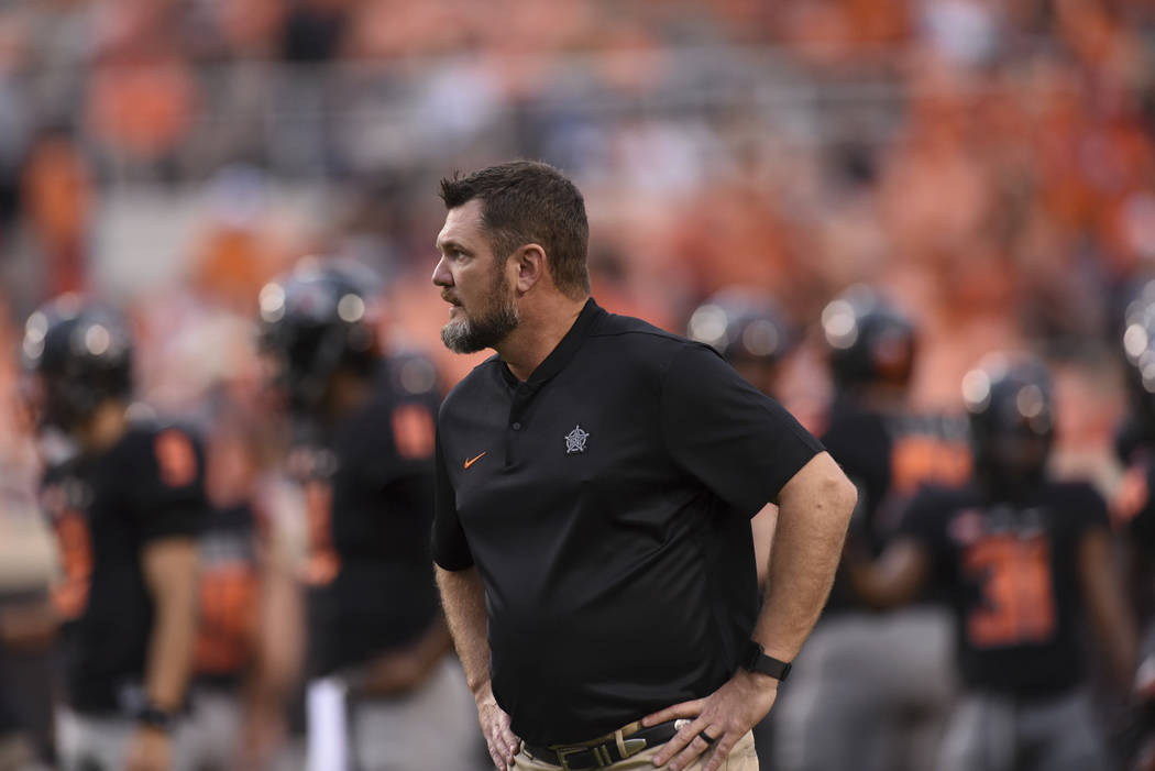 Oklahoma State defensive line coach Joe Bob Clements looks over his team during an NCAA college ...