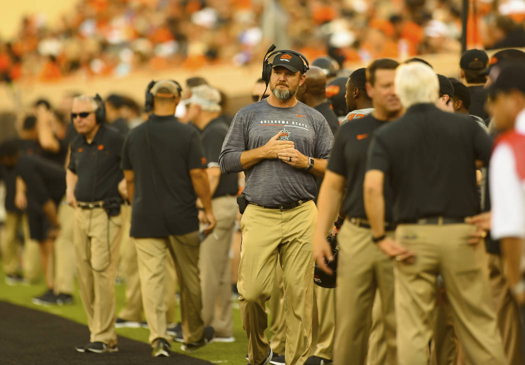 Oklahoma State defensive line coach Joe Bob Clements looks across the field during the first ha ...