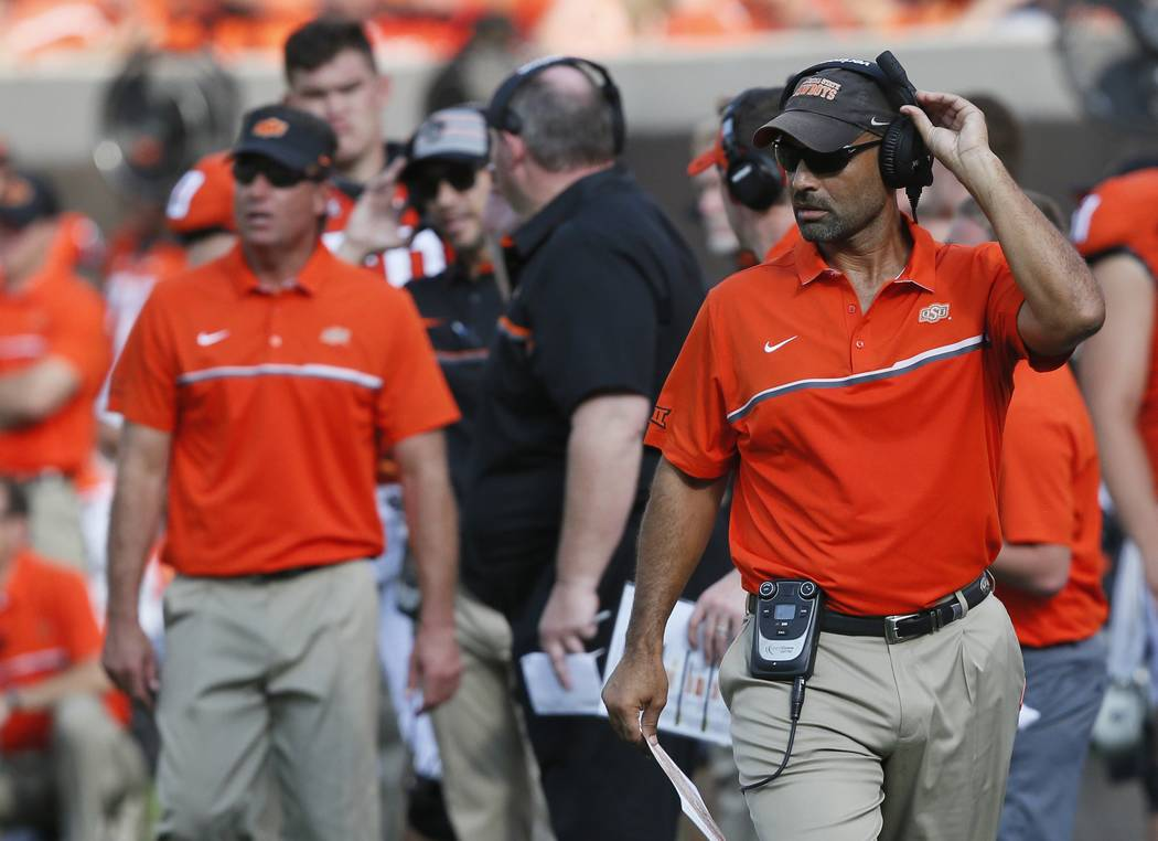 In this Saturday, Sept. 3, 2016 photo, Oklahoma State receivers coach Kasey Dunn is pictured on ...