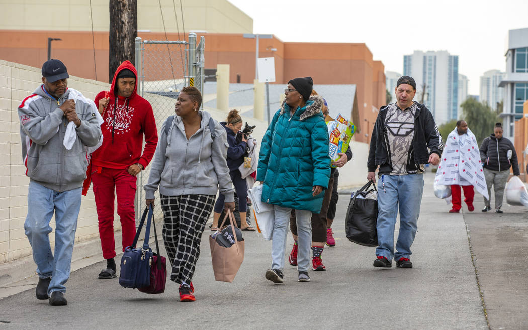 Alpine Motel Apartments residents depart the American Red Cross temporary shelter for fire vict ...