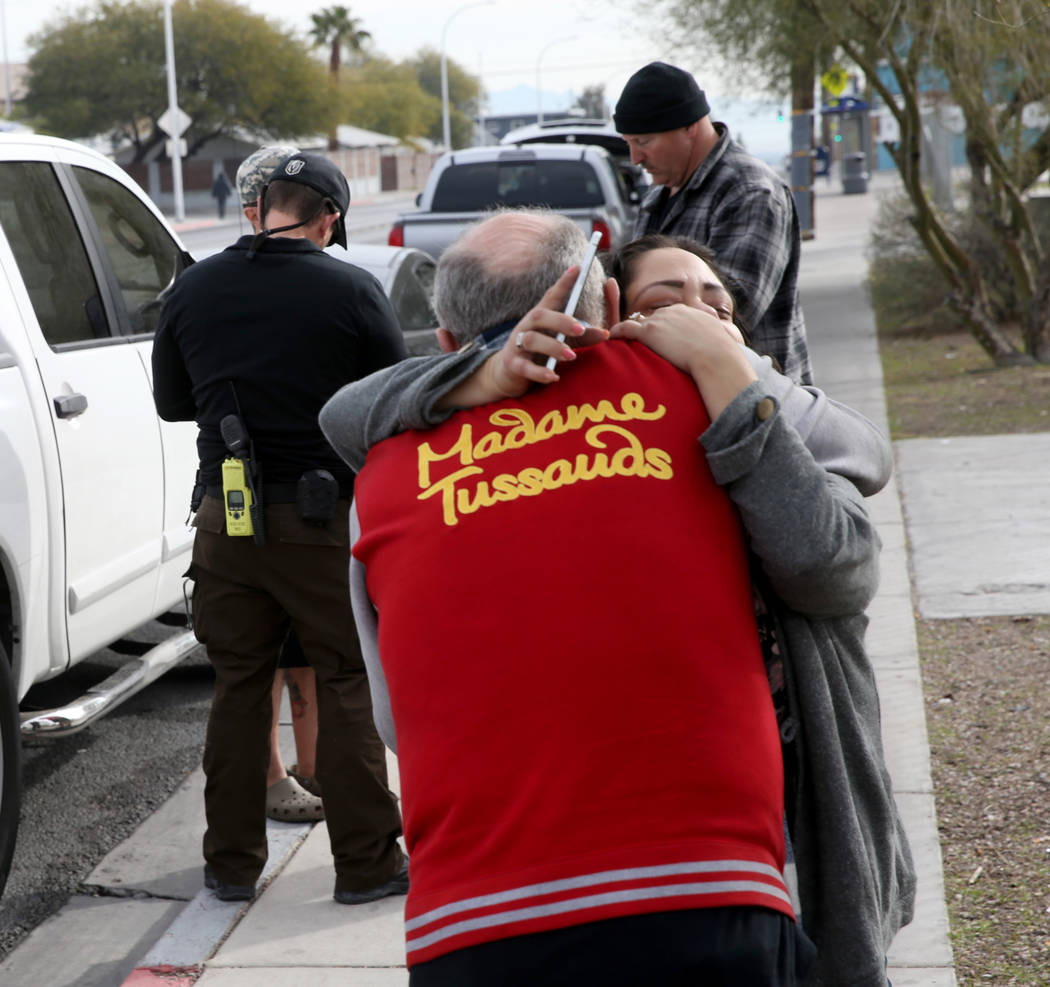 Alpine Motel Apartments resident Kelvin Salyers hugs co-owner Malinda Mier after a fire left 6 ...
