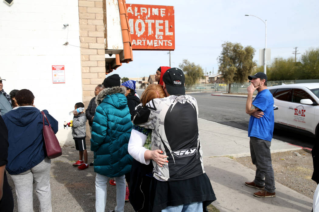 Residents Matthew Sykes comforts his wife Thelma at Alpine Motel Apartments after a fire left 6 ...