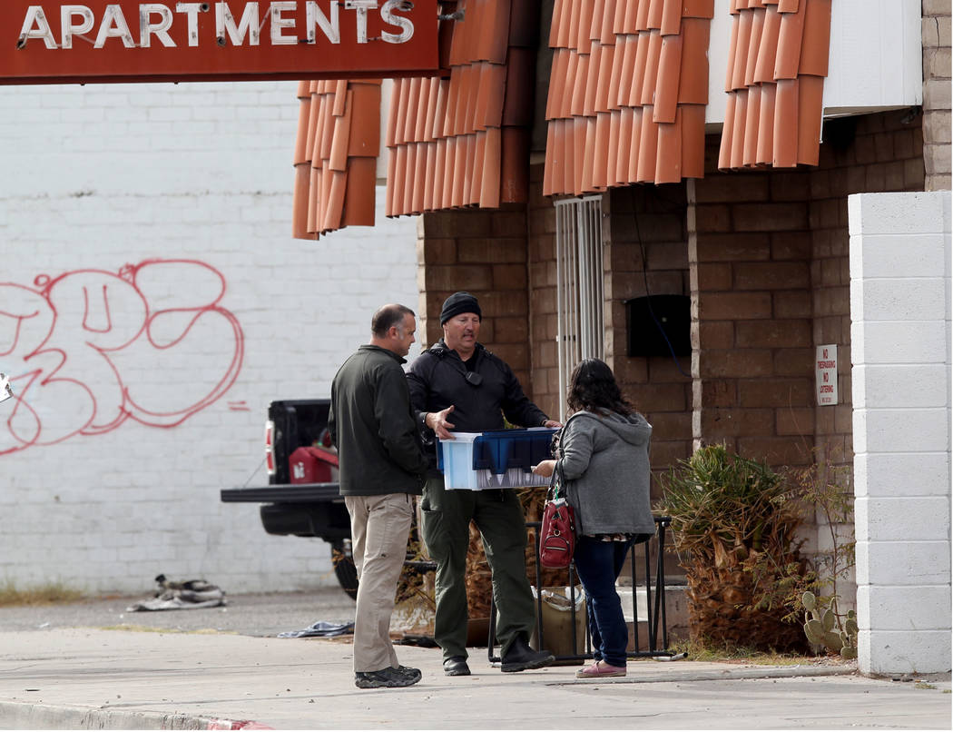 Fire officials talks to co-owner Malinda Mier, right, at Alpine Motel Apartments after a fire l ...