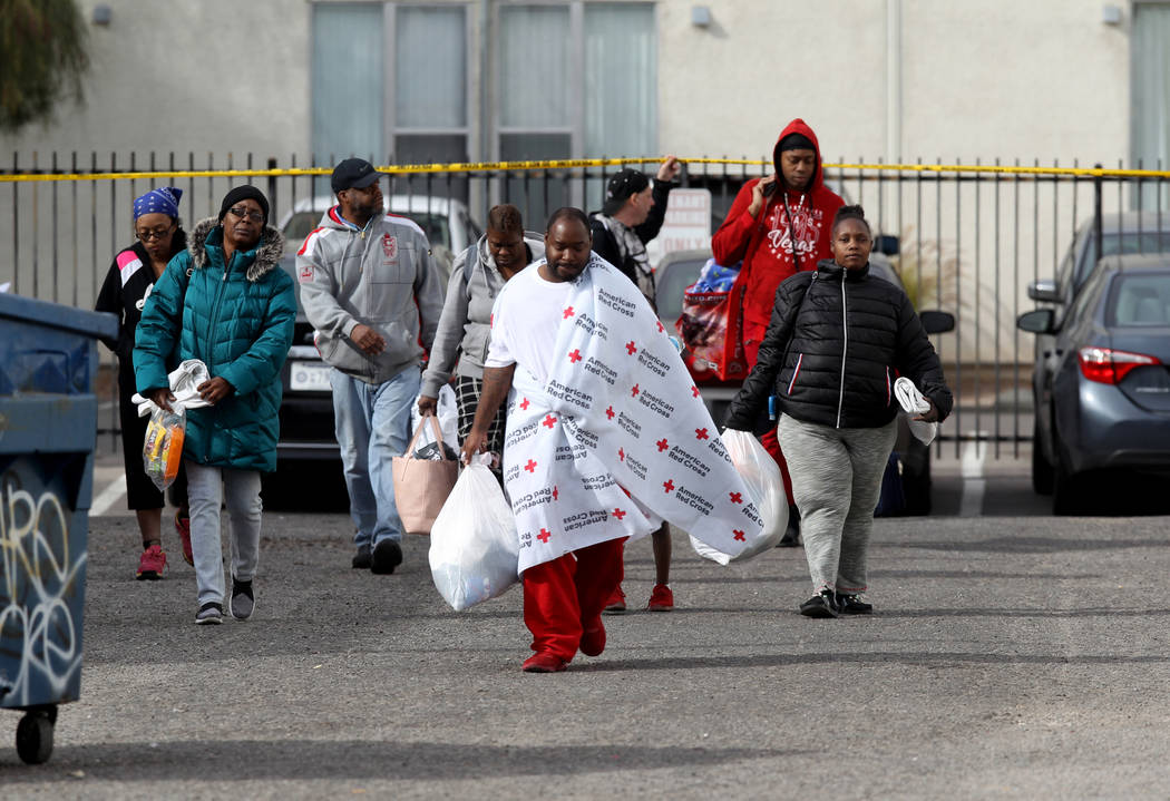 Residents, including Jimmy Lacy, center, and his girlfriend Dayshena Thomas, right, at Alpine M ...