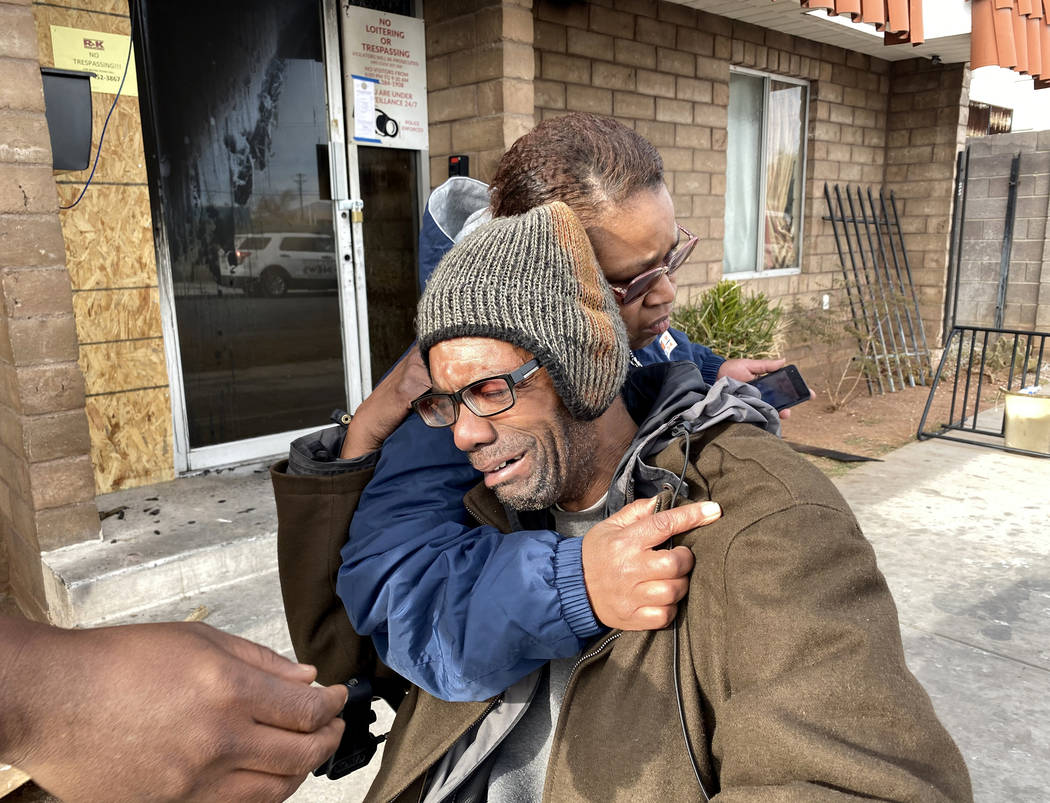 Victor Cotton gets a hug from fellow resident Tia Dotson at Alpine Motel Apartments after a fir ...