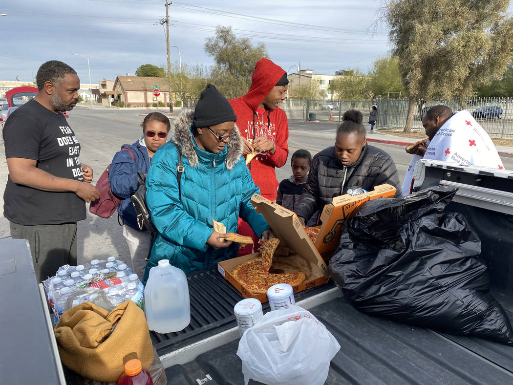 Residents, from left, Markas Combs, Tia Dotson, Stephanie Couch, Timothy Henry, Andru Roach, 7, ...